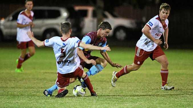 FOOTBALL ACTION: Bargara FC's Anthony Grant brings down Brothers Aston Villa player Johnathan Chapman at Martens Oval.