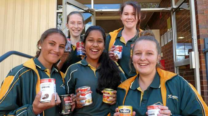 HELPING OUT: Centenary Heights State High School students (back, from left) Britney Thomson and Jade Wieting and (front, from left) Tahnia King, Tharushi Gamage and Tiana Beauchamp show their support for the Lifeline Can Appeal.