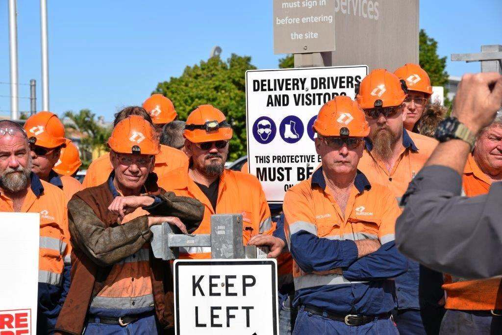 RALLY DAY: Aurizon workers devastated about losing their jobs have gathered out the front of the company's Bolsover St workshop.