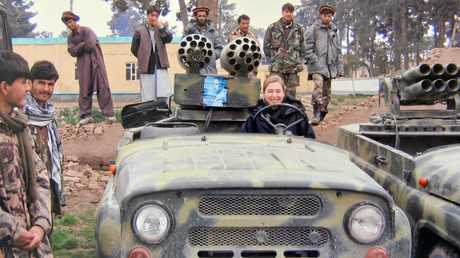 Ingrid Hayden gets some driving practice during her post in Afghanistan.