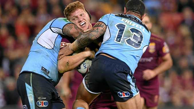 Dylan Napa of the Queensland Maroons is held up by the Blues defence.