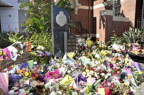 The floral sea at the makeshift memorial for Senior Constable Brett Forte at Toowoomba police headquarters.