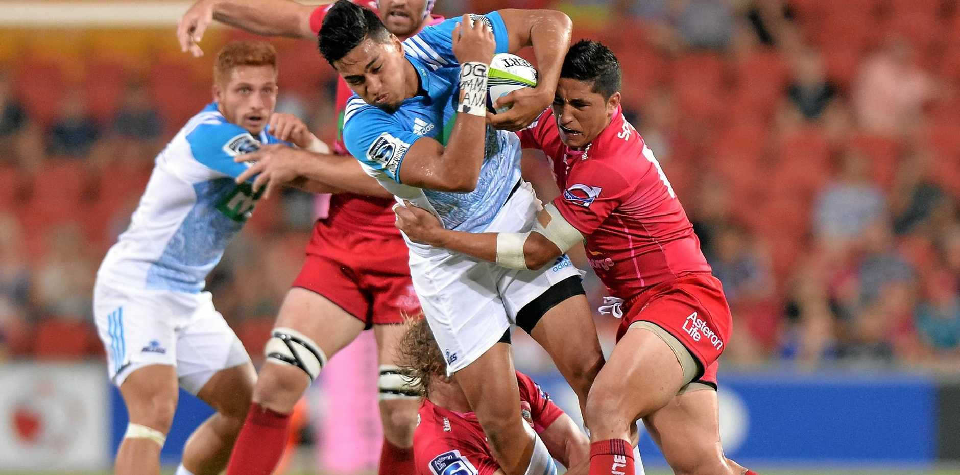 Rieko Ioane of the Blues is tackled by the Reds at Suncorp Stadium in 2016.
