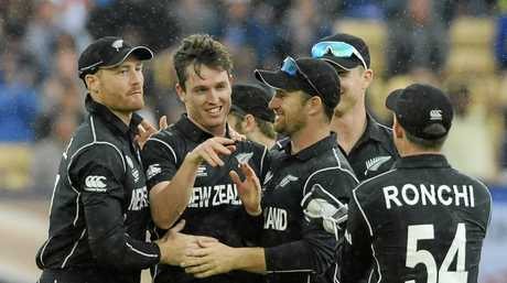 Teammates congratulate New Zealand's Adam Milne for the dismissal of Australia's Moises Henriques.
