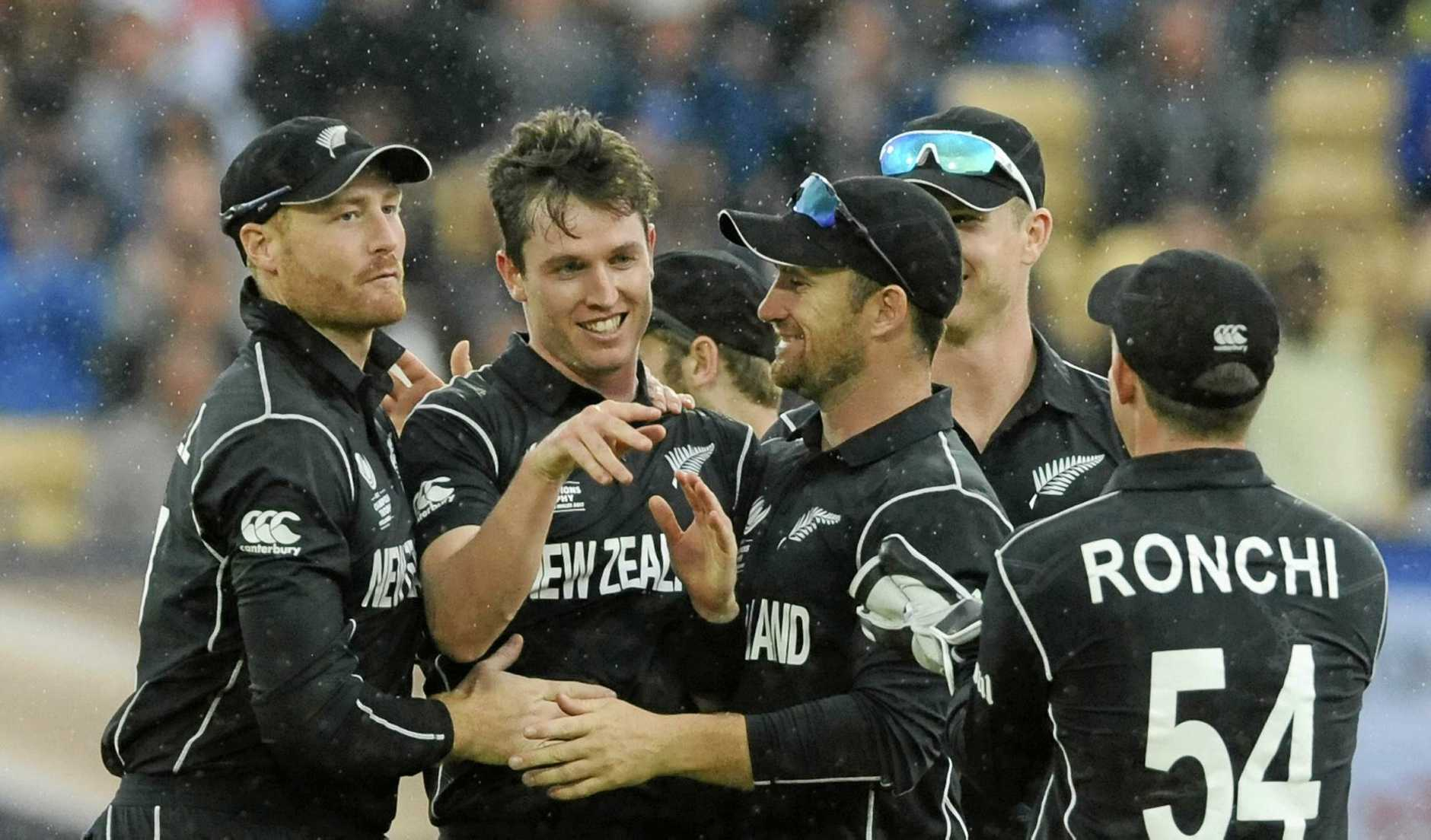 Teammates congratulate New Zealand's Adam Milne for the dismissal of Australia's Moises Henriques during the ICC Champions Trophy match between Australia and New Zealand at Edgbaston in Birmingham, England, Friday, June 2, 2017. (AP Photo/Rui Vieira)