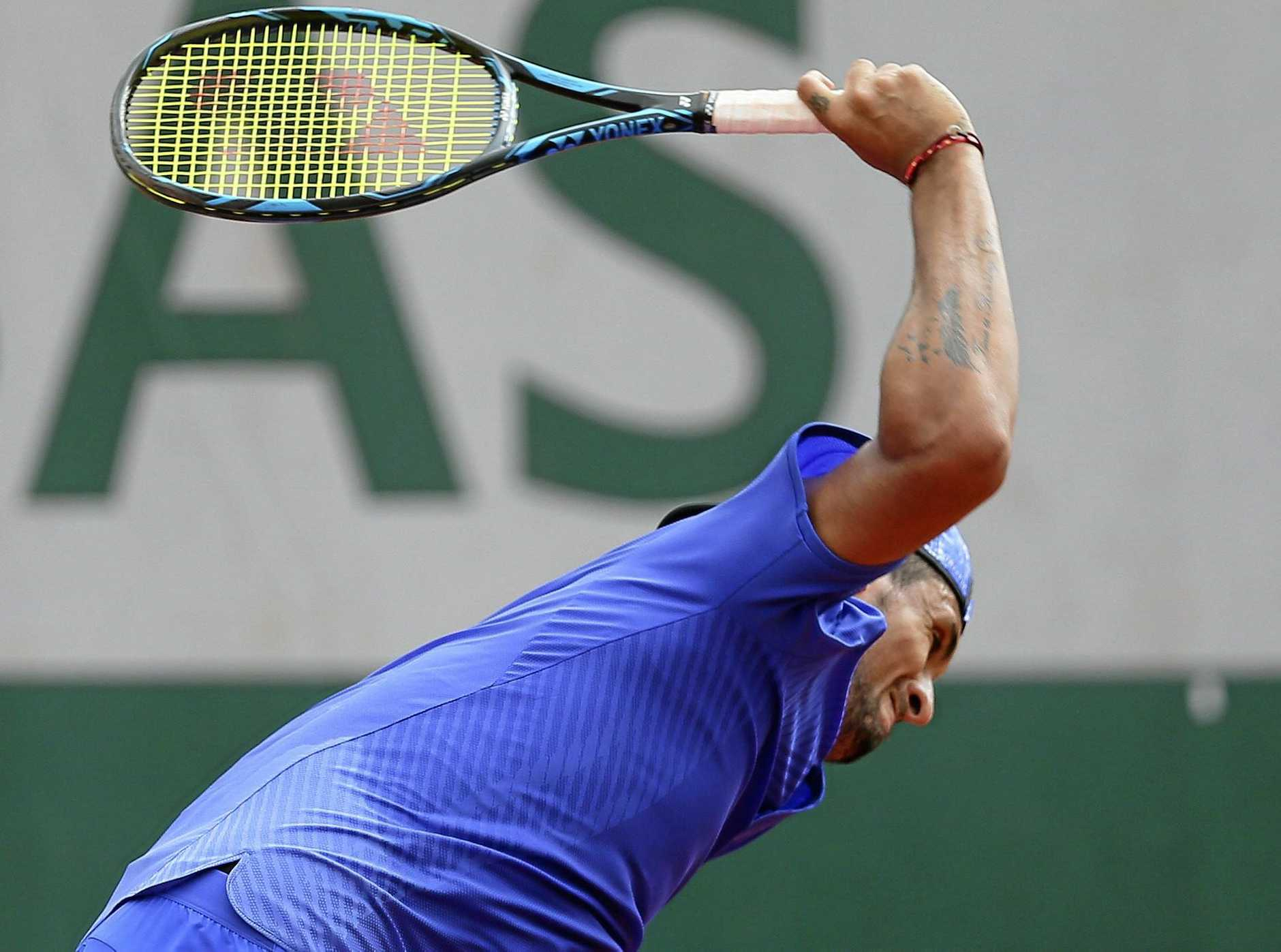 Australia's Nick Kyrgios breaks his racket in his second round match against South Africa's Kevin Anderson at the French Open.