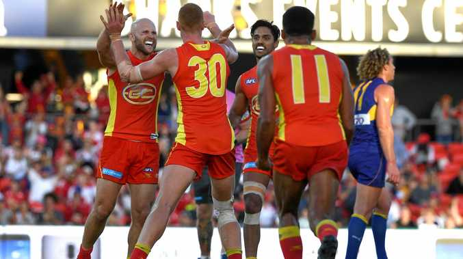 Suns player Peter Wright reacts with Gary Ablett after kicking the winning goal against West Coast.