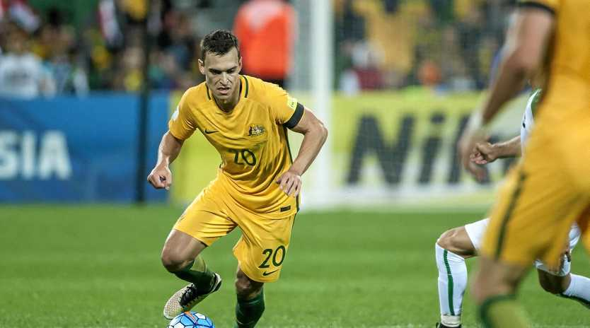 Trent Sainsbury playing for the Socceroos.