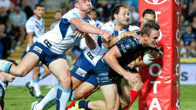 Coen Hess scores a try for the Cowboys.