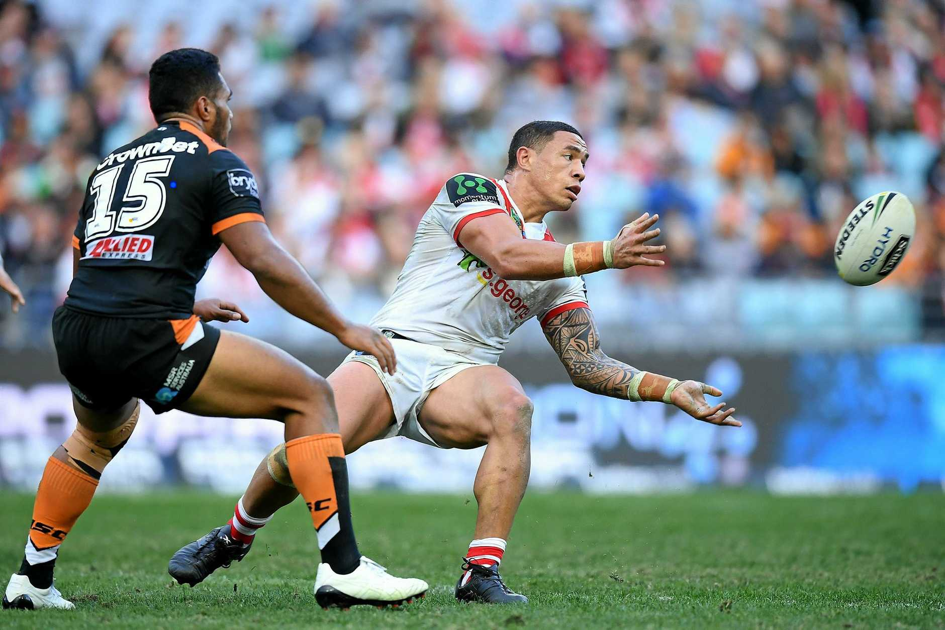 Tyson Frizell of the Dragons offloads a pass against the Tigers.
