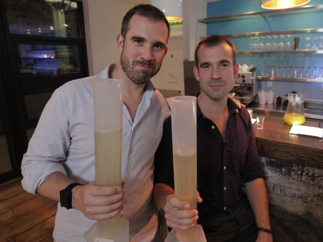 Dr Xand van Tulleken (left) & Dr Chris van Tulleken (right) holding their own urine, collected as part of their research on binge drinking.Source:Supplied