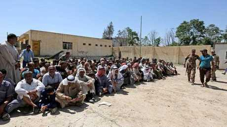 Iraqi men waiting at a security center to have their names checked by Iraqi forces to ensure that they are not members of the so-called 'Islamic State' (IS), at the al-Oraibi district in western Mosul, Iraq, 03 June 2017.