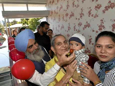 The owners parents (from left) Jasveer Singh Jammu, Narender Kaur holding grandson Ekamvir Jammu and co-owner Gurpreet Kaur at the opening of Ice 'n' Spice new restaurant in High Street shopping centre, Thursday, June 1, 2017.