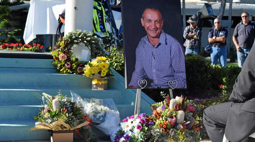 Floral tributes were laid next to a photograph of Frank Marchetti at his memorial service at Jubilee Park on Saturday, June 3, 2017.