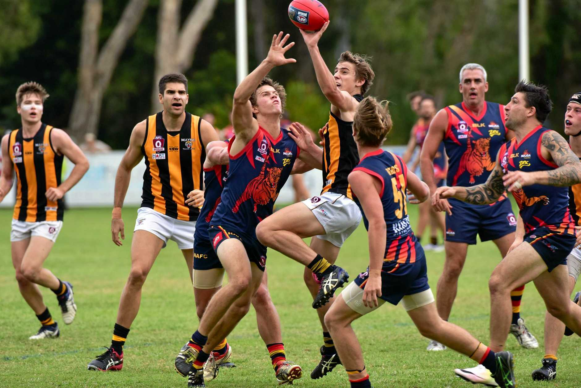 Noosa and Mayne players battle for possession in a previous game.