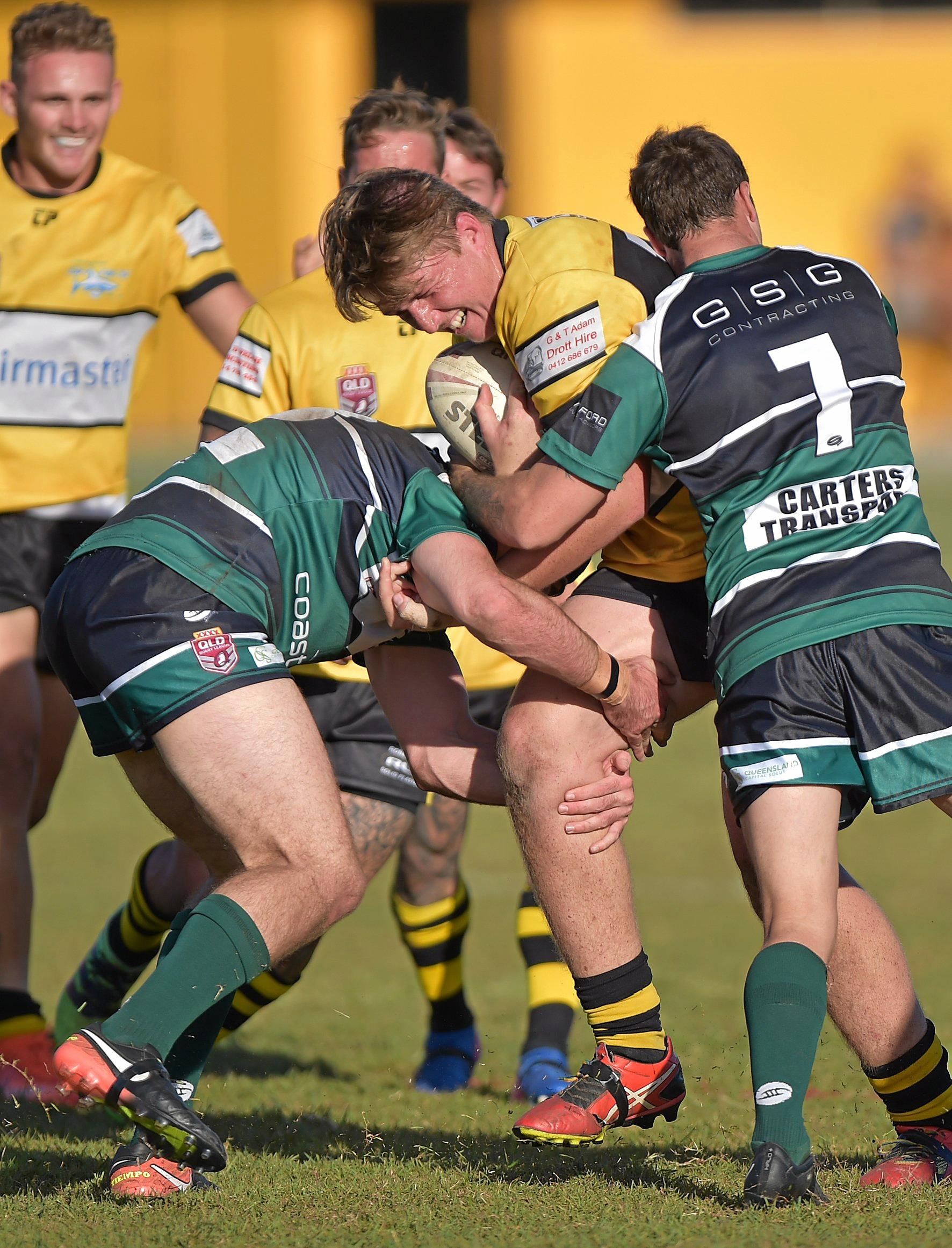 CRUNCH: Caloundra forward Mat McDermott is tackled by the Maroochydore defence at Shark Park on Sunday.