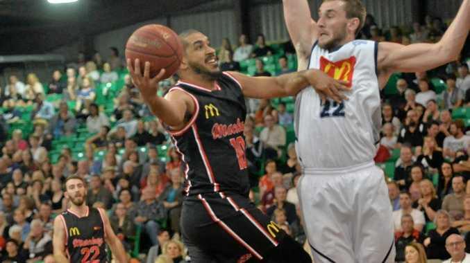 Mackay McDonald's Meteors Chris Cedar goes up for the basket.