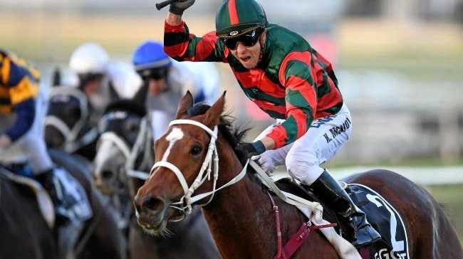 Jockey Kerrin McEvoy and Egg Tart claim the Group 1 Queensland Oaks at Doomben. Picture: AAP