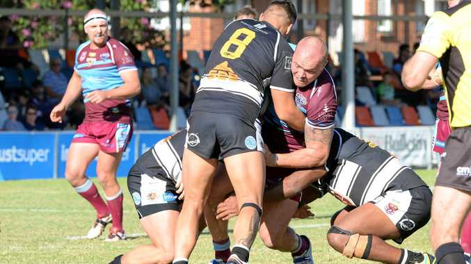 Front rower Matt Groat, who was one of the Capras best, is wrapped up by some solid Tweed Heads defence in the Intrust Super Cup clash at Browne Park yesterday.
