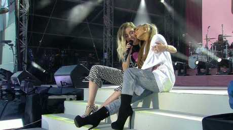 Miley Cyrus and Ariana Grande on stage at One Love Manchester