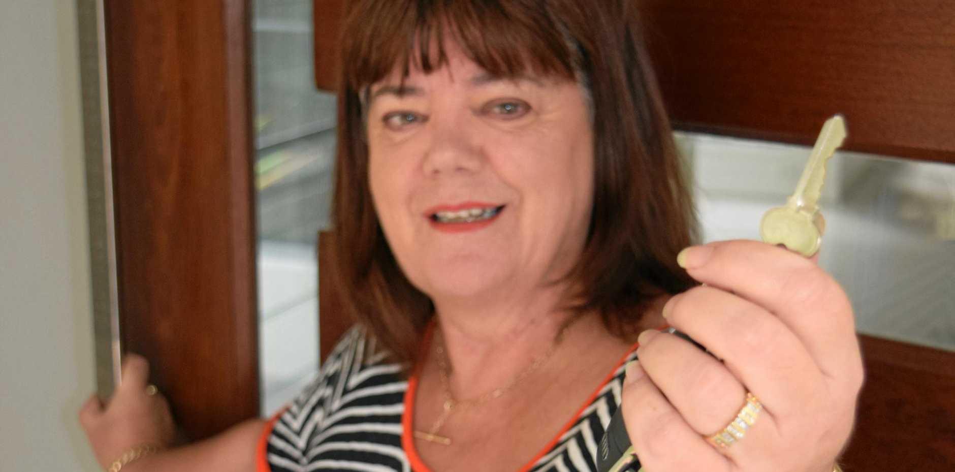 MILESTONE: Carol Raye opens the door to the new hospice.