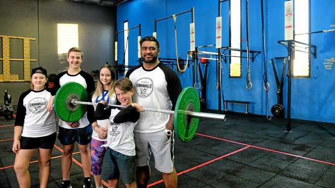 STRONG TIES: Ipswich Barbell Club members (front) Finn Lamond, (back) Charlie Utz, Adelaide Utz, Breanna Gow and head coach Jax Solofa have returned from the Queensland Weightlifting U15/Youth Championships with some impressive results.