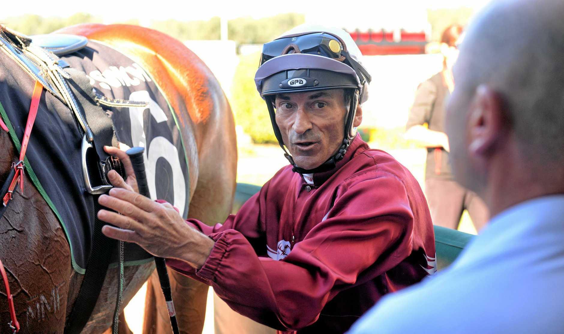 Jockey Robbie Fradd returns to the Ipswich enclosure after his winning ride aboard Divine Unicorn at the Bundamba Racetrack on Wednesday.