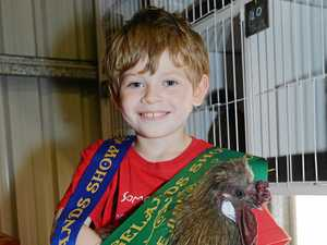 Family clucking with pride after taking out top gong at CQ show
