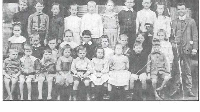 IN THE BEGINNING: First-year pupils with head teacher Donald Price in 1910.