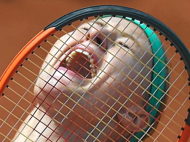 Kristina Mladenovic celebrates after her big win over Garbine Muguruza. Photo: AFP