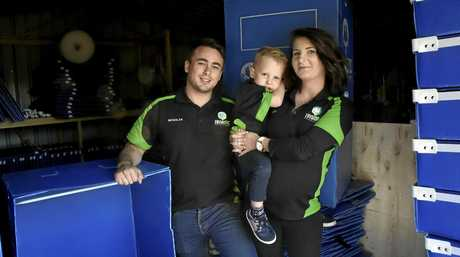 New business, Toowoomba couple start a service renting environmentally-friendly moving boxes. Enviropac Rentals  owners Ashleigh Smith and Nic Knight with four-year-old son Lynkon Knight . June 2017