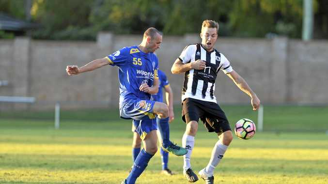 CUP SUCCESS: Trent Bowles of USQ against Brock Tuesley of Willowburn in the Toowoomba Football League men's President's Cup game.