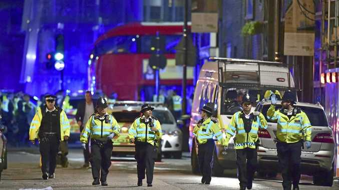 Police officers on Borough High Street as police are dealing with an incident on London Bridge in London, Saturday, June 3, 2017.    Witnesses reported a vehicle hitting pedestrians and injured people on the ground. (Dominic Lipinski/PA via AP)
