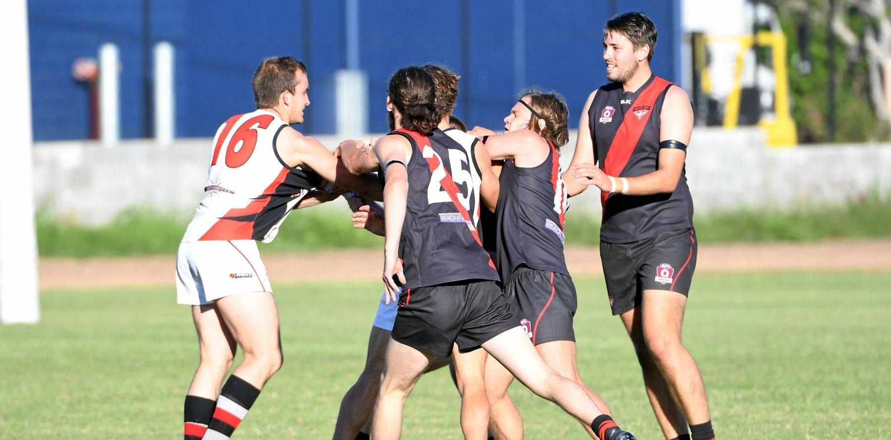 PHYSICAL: One of the scuffles as Bombers beat Bulldogs at Brothers Sports Complex.