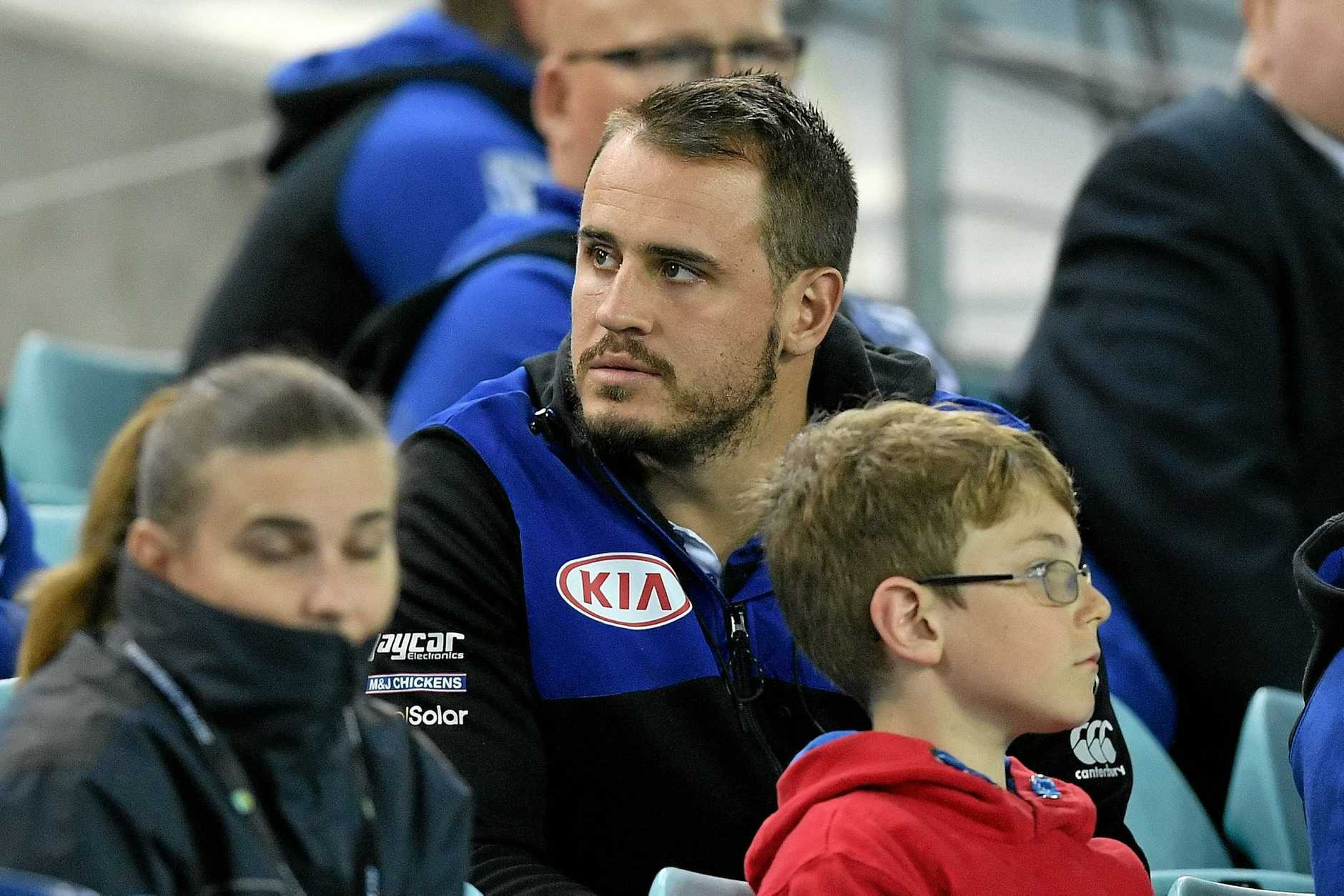 Josh Reynolds watches on from the stands in round 10 after injuring his hamstring.