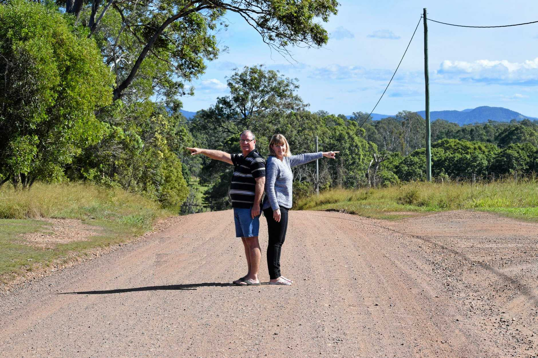SPLIT: Lee and Colleen Wason on the road that cuts through their property, which was the central point on their recent appeal win against a Gympie Regional Council decision.