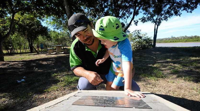 Jason and Jacob Donovan look at thew memorial to Kenny Donovan at Donovan Park.
