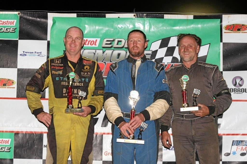 BIG WIN: Terry Leerentveld (centre) won the V8 Dirt Modifieds final at Lismore Speedway Sunday night