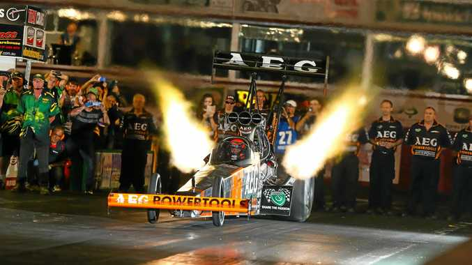 FIRE FLIES: Darren Morgan fires up his dragster on track.