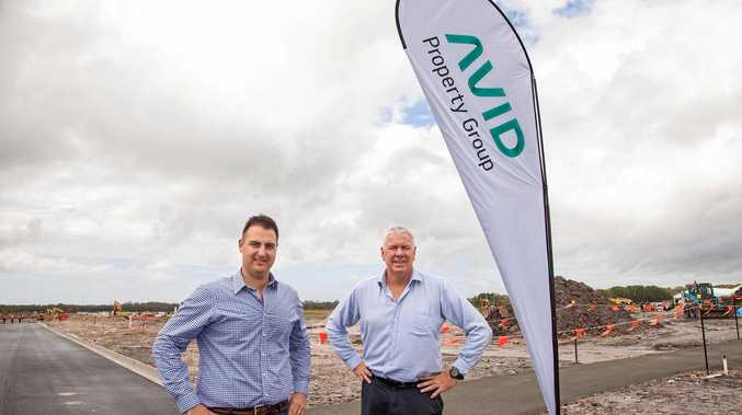 AVID Property Group's Harmony development manager Anthony Demiris and general manager Qld Bruce Harper on site at Palmview earlier this year. Mr Harper has vowed the opening stage will be complete by month's end.