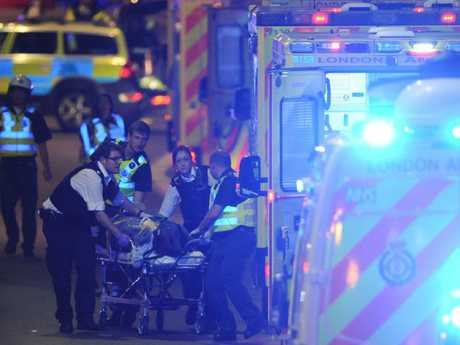 Patients were treated on the side of the road and a British transport police member was among those injured. Picture: AFP PHOTO / DANIEL SORABJISource:AFP