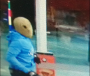 A man armed with a gun robbed a Glass House Mountains service station overnight.
