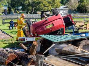 LUCKY ESCAPE: Car flips into display yard