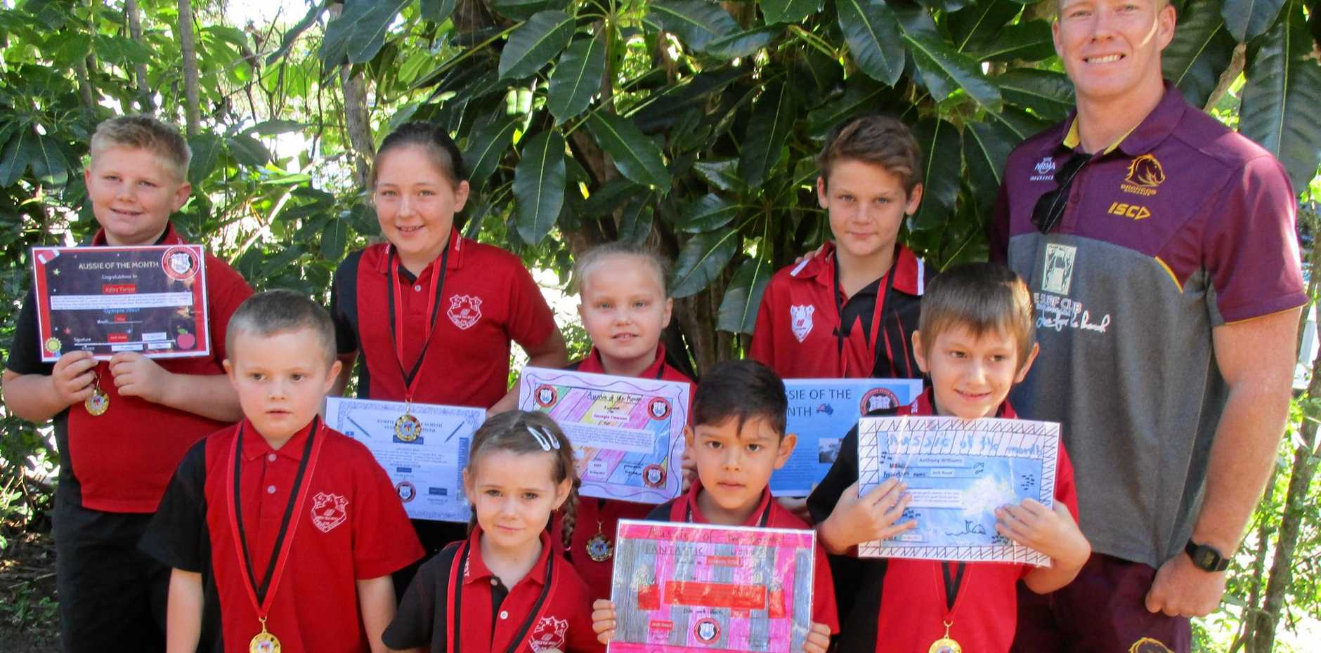 GREAT EFFORT: Former Bronco Jack Reed (right) with Gympie West Aussies of the Month (back from left) Ryley Turner, Olivia Lesslie, Georgie Dawson, Duey Barry, (front) Joseph Wickham, Kaelee Faint, Hudson Prisk and Anthony Williams.