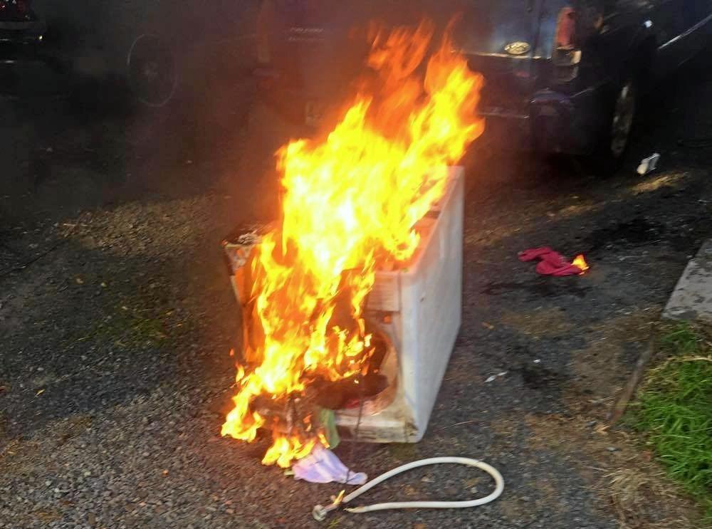 Jesse Bonell's Samsung washing machine on fire.