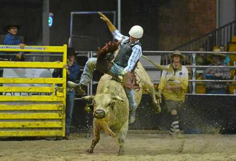 Jordan Iker with an 80 point ride in the Rookie Bull Ride at the Bulls and Barrels Rodeo at the Great Western Hotel.