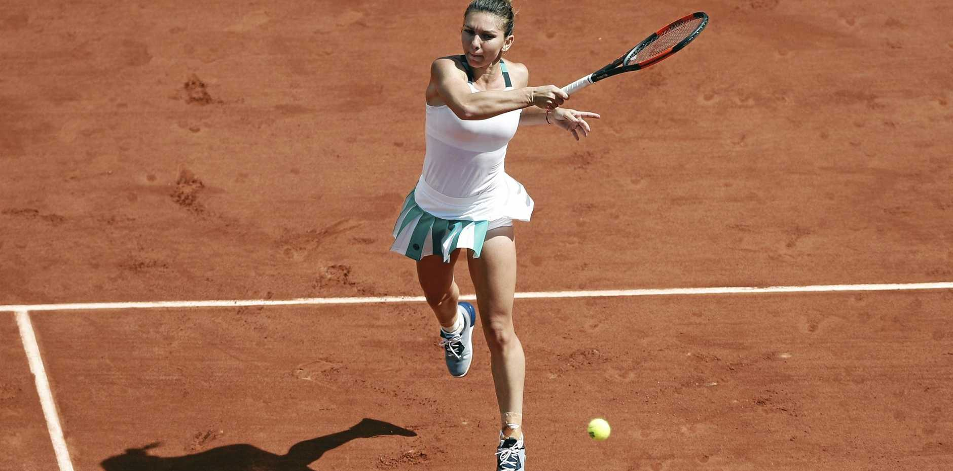 Simona Halep of Romania in action against Carla Suarez Navarro of Spain at the French Open.