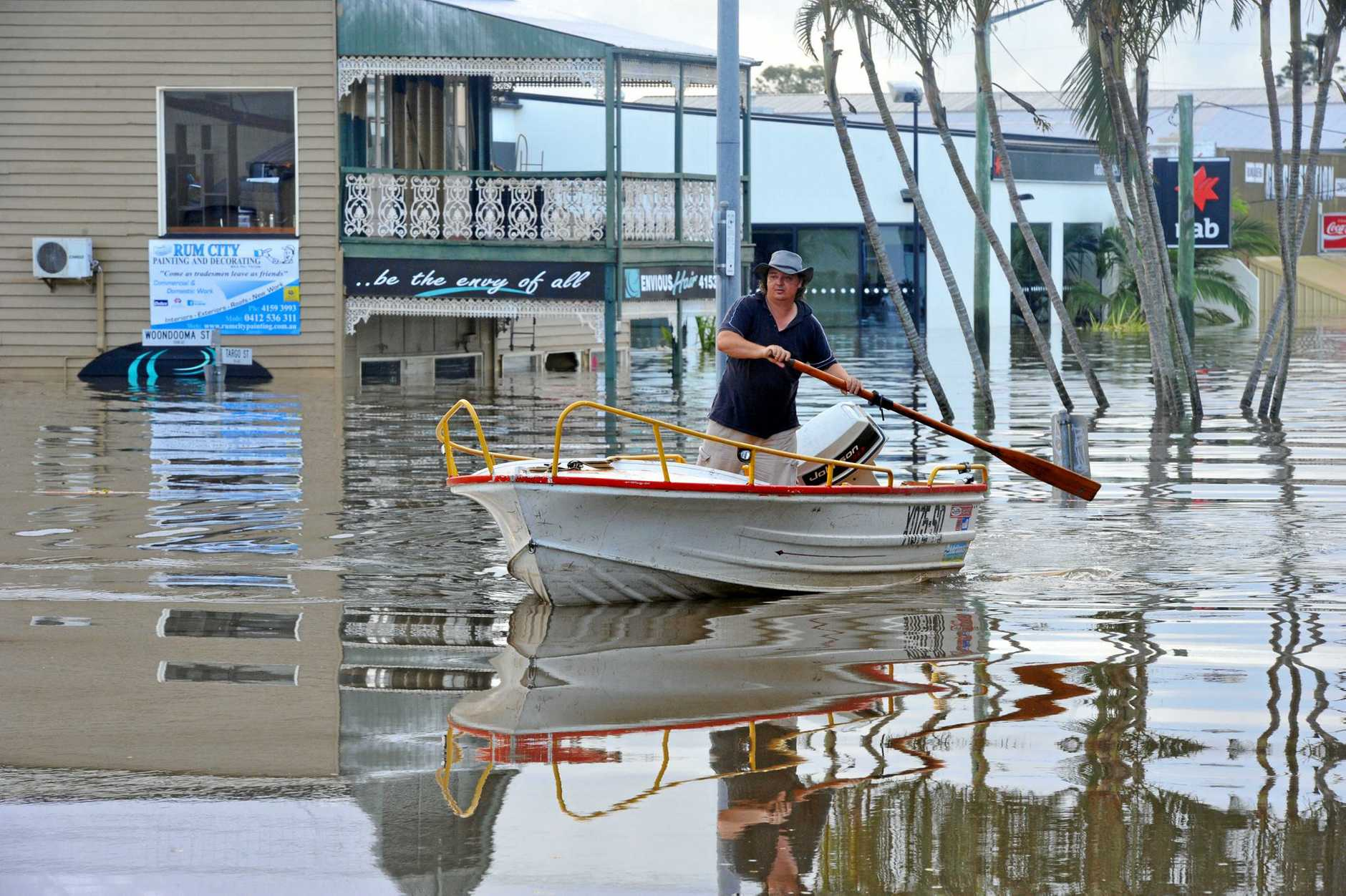NOT AGAIN: Envious Hair on the corner of Targo and Woondooma streets is flooded out once again as record level floodwaters swallow Bundaberg. Photo: Max Fleet / NewsMail