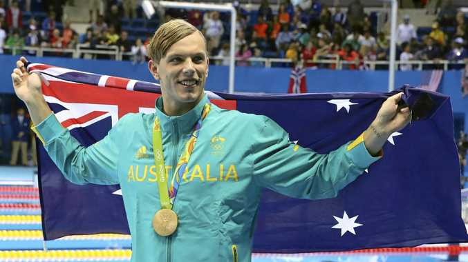 Australia's Kyle Chalmers celebrates after winning gold in the 100m freestyle at the Rio Olympics.