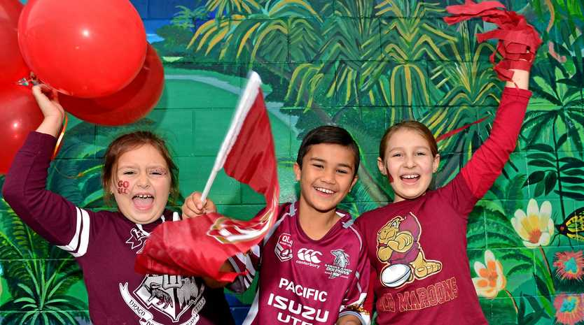 STATE PRIDE: Buddina State School grade 3 students Ava, Daniel and Makenzie celebrate Queensland Day.